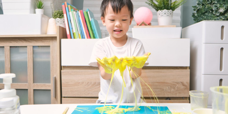 yellow slime, child playing, homemade slime, homemade goop, pet toxins, pet toxicity, toxic crafts, homemade slime toxicity in pets, homemade slime toxicity, homemade crafts, art supplies